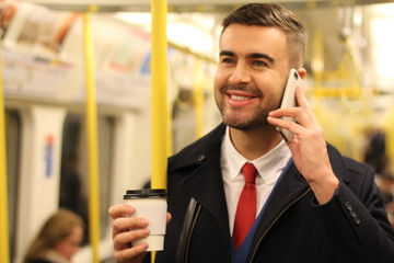 Businessman calling by phone while commuting