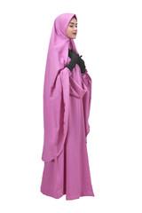 Beautiful asian muslim woman in veil praying