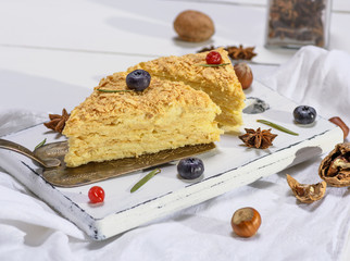 a piece of baked pie Napoleon with a cream