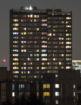 Towerblock at night, showing the variety of lives and lights that exist in a single apartment block in London