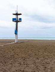 lifeguard tower on a beach.