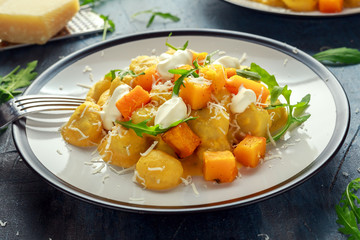Homemade Butternut squash gnocchi with wild rocket and parmesan, ricotta cheese