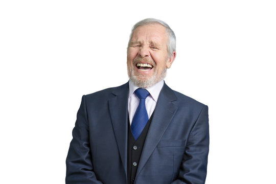 Senior businessman laughing hard. Portrait of old grey haired man in suit. White isolated bacgrkound.