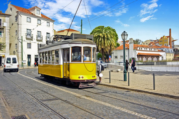 Historical tram driving in Lisbon Portugal
