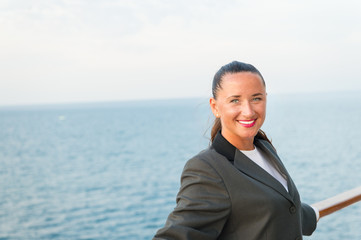 Travelling for business. Sensual woman smile on ship board on blue sea. Woman in business jacket on shipboard in miami, usa. Fashion, beauty, look. Wanderlust, adventure, discovery, journey