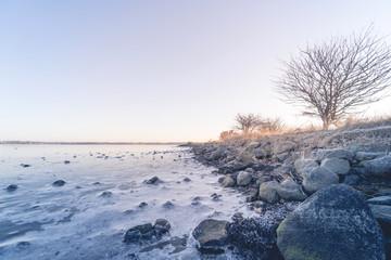 Coastline by a frozen sea in the winter