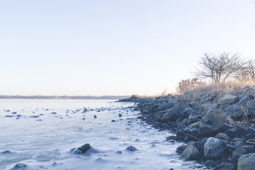 Rocks in the frozen sea on a coastline