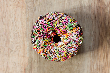 Donuts on a wooden background. Free space for text. Top view.