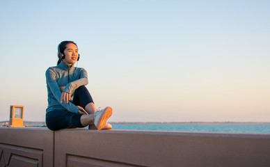 Girl enjoying time outside and listening to music with headphones