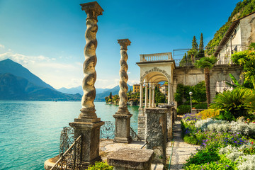 Wall Mural - Mediterranean flowers and villa Monastero in background, lake Como, Varenna