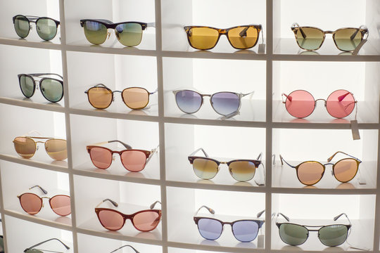 Various of sun glasses in the shop display shelves