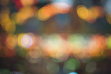 Blurred fairy lights, abstract texture of glowing lights - Christmas background texture, glitter sparkle - Colorful bokeh background, circles