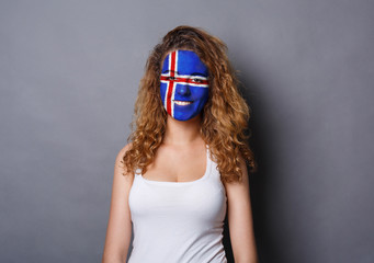 Young woman with Iceland flag painted on her face
