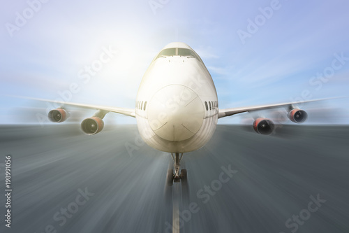 Airplane speed takeoff at runway in airport/motion blur