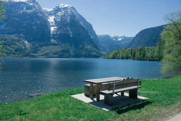 Love seat at lake in summer