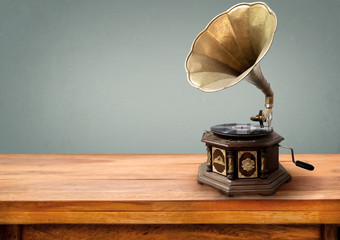 Vintage gramophone, retro music player technology. vintage gray background