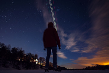 The guy looks at the stars the frosty winter night