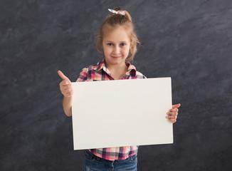 Little girl holding blank white banner