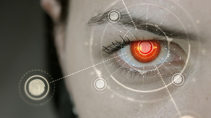 Young cyborg female blinks then fingerprint symbols appears.