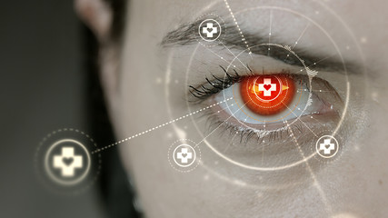 Young cyborg female blinks then first aid symbols appears.