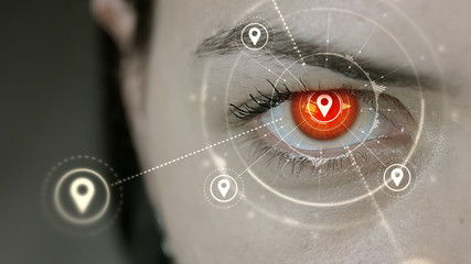 Young cyborg female blinks then location pin symbols appears.