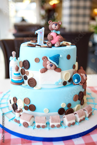 Round Multi Tiered Blue Birthday Cake Decorated With Button Toys Bears Locomotive And