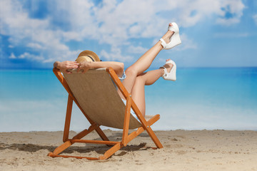 A girl on the beach sunbathing in a chaise lounger. Summer mood. Vacation.
