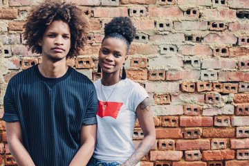 Young black teen couple. Dark skin, mixed race, voluminous african hair