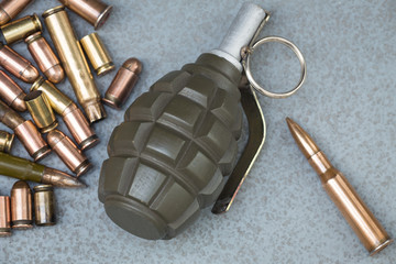 Hand grenade, cartridges and scales from various types of weapons.