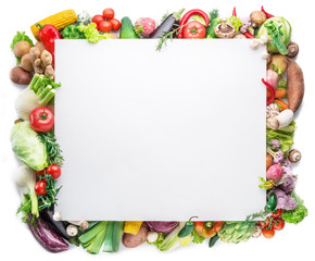 Different colorful vegetables arranged as a frame on white background.