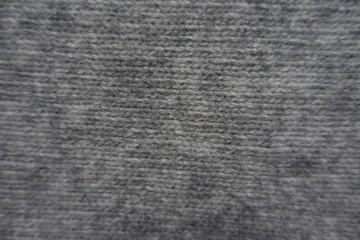 Surface of gray handmade stocking stitch knitted fabric from above