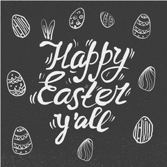 happy Easter Hand drawn lettering with eggs and rabbit ears. design for holiday greeting card and invitation on chalkboard