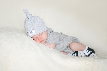 A newborn infant, the baby is sleeping lying on his stomach on a soft blanket