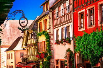 Fototapete - Colorful traditional half-timbered houses of Alsace in France, Riquewihr town