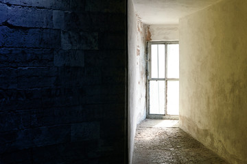 Bright window in the dungeon or in the bunker. Image divided into two halves