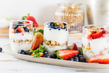 Little Jars with layered dessert from natural yogurt, granola an