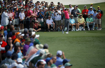 Tiger Woods of the U.S. hits off the third tee during practice for the 2018 Masters golf tournament in Augusta