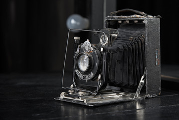 retro photo camera on a dark table