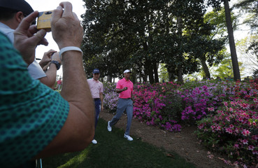 Patrons take pictures of Tiger Woods of the U.S. during practice for the 2018 Masters golf tournament at Augusta National Golf Club in Augusta