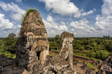 A temple with treess and roots over the walls in the Angkor Wat Complex near Sim Reap in Cambodia