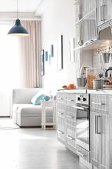 Modern kitchen interior in light apartment