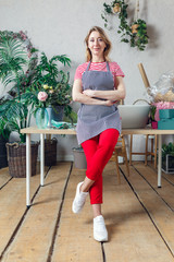 Picture of florist in apron with crossed hands