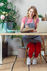 Imageof florist woman with notebook at table with laptop