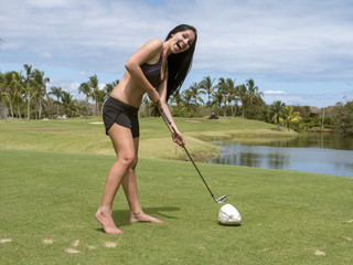 Girl with a club on a golf course