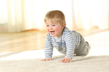 Cute baby crawling and laughing on the floor