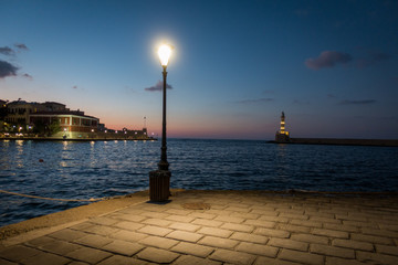 Illuminated street light with seascape backdrop, Chania town, Crete, Greece