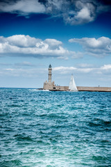 Old harbor, lighthouse, sailboat, Chania, Crete, Greece