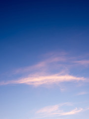 Fluffy clouds in the blue sky with morning light from the sunrise