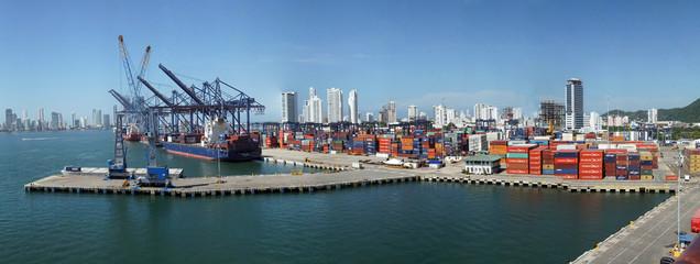 Container cargo cranes & city skyline