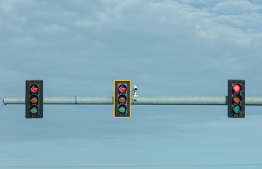 traffic camera watches a busy intersection for traffic safety and compliance